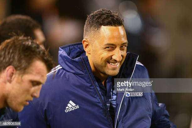 Benji Marshall of the Blues grins as he stretches on the bench during the round eight Super Rugby match between the Brumbies and the Bulls at...