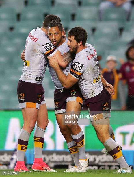 Benji Marshall of the Broncos celebrates with team mates after scoring a try during the round 13 NRL match between the Sydney Roosters and the...