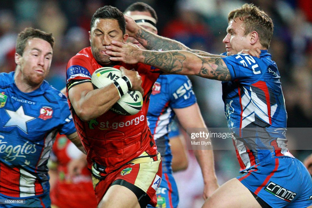 Benji Marshall of the Dragons breaks through a tackle to score a try during the round 21 NRL match between the Sydney Roosters and the St George Illawarra Dragons at Allianz Stadium on August 2, 2014 in Sydney, Australia.
