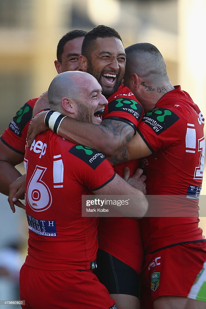 Benji Marshall of the Dragons celebrates with his team mates after scoring a try during the round 10 NRL match between the St George Illawarra Dragons and the Canberra Raiders at WIN Stadium on May 17, 2015 in Wollongong, Australia.