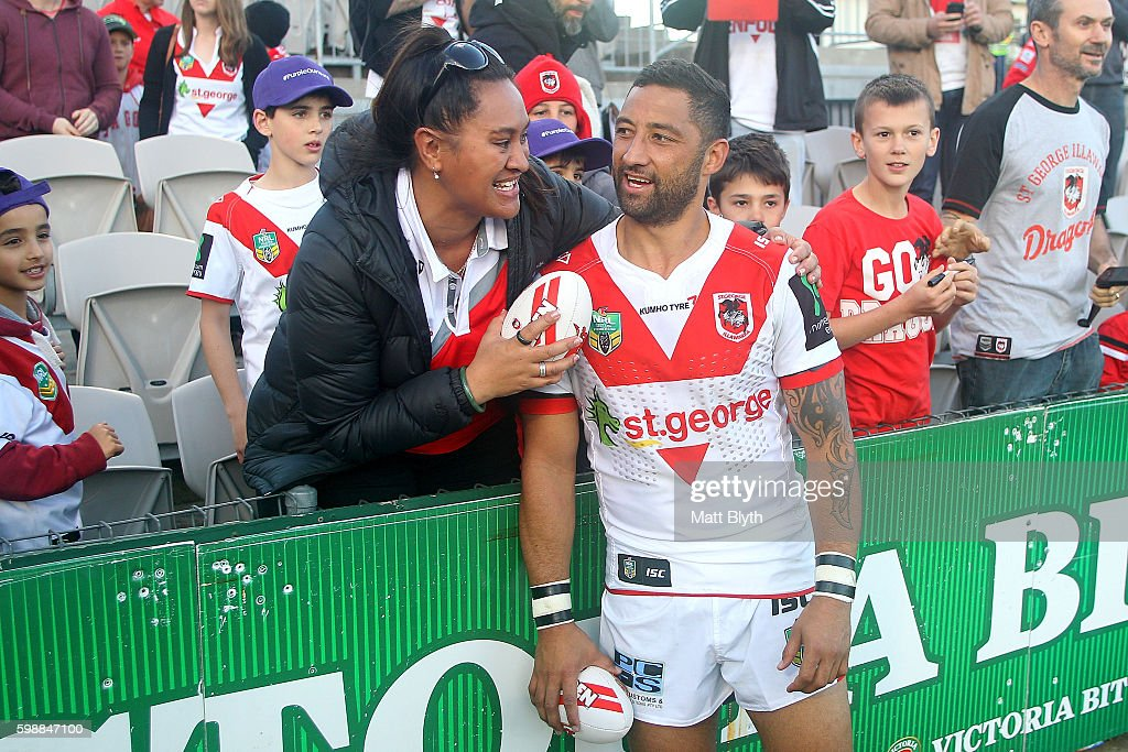 Benji Marshall of the Dragons poses for a photo with a fan after the round 26 NRL match between the St George Illawarra Dragons and the Newcastle Knights at WIN Jubilee Stadium on September 3, 2016 in Sydney, Australia.