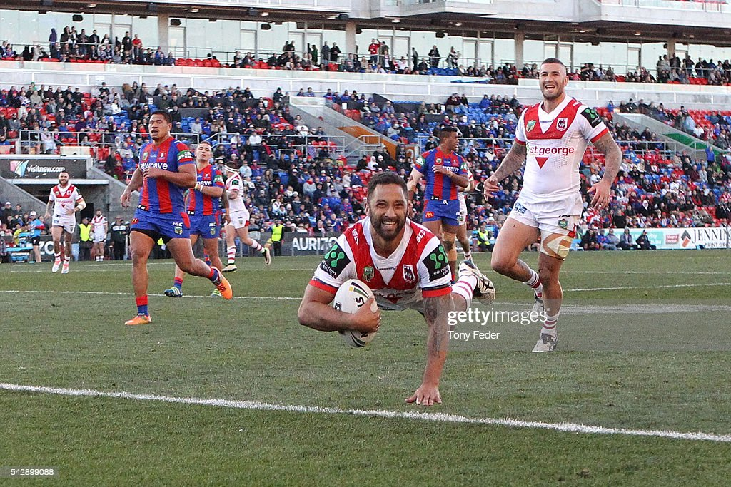 Benji Marshall of the Dragons scores a try during the round 16 NRL match between the Newcastle Knights and the St George Illawarra Dragons at Hunter Stadium on June 25, 2016 in Newcastle, Australia.