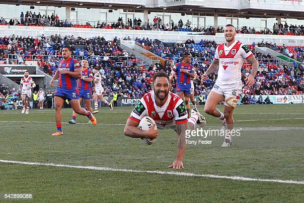 Benji Marshall of the Dragons scores a try during the round 16 NRL match between the Newcastle Knights and the St George Illawarra Dragons at Hunter...