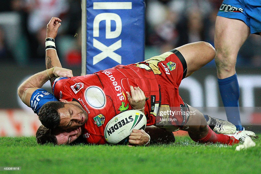 Benji Marshall of the Dragons scores a try during the round 21 NRL match between the Sydney Roosters and the St George Illawarra Dragons at Allianz Stadium on August 2, 2014 in Sydney, Australia.