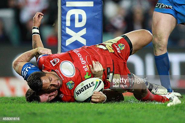 Benji Marshall of the Dragons scores a try during the round 21 NRL match between the Sydney Roosters and the St George Illawarra Dragons at Allianz...