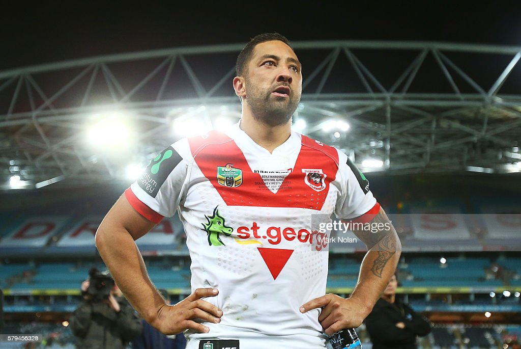 Benji Marshall of the Dragons watches fans perform a haka for his 250th game after the round 20 NRL match between the St George Illawarra Dragons and the Wests Tigers at ANZ Stadium on July 24, 2016 in Sydney, Australia.