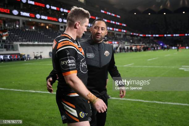 Benji Marshall of the Tigers and Chris Lawrence of the Tigers thank fans after playing their last game for the Tigers following the round 20 NRL...