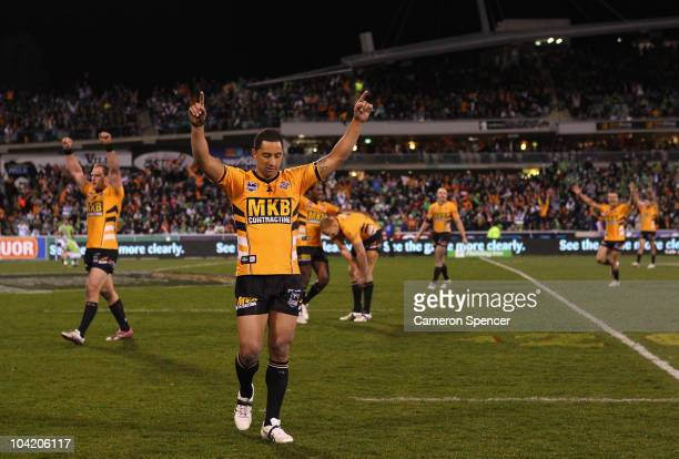Benji Marshall of the Tigers and team mates celebrate winning the first NRL semi final match between the Canberra Raiders and the Wests Tigers at...