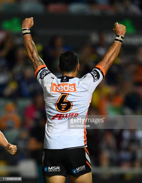 Benji Marshall of the Tigers celebrates after kicking the winning field goal during the round 14 NRL match between the North Queensland Cowboys and...