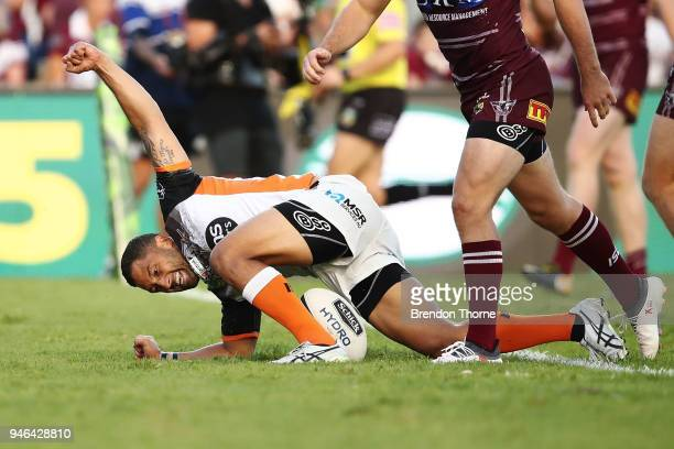 Benji Marshall of the Tigers celebrates after scoring a try during the round six NRL match between the Manly Sea Eagles and the Wests Tigers at...
