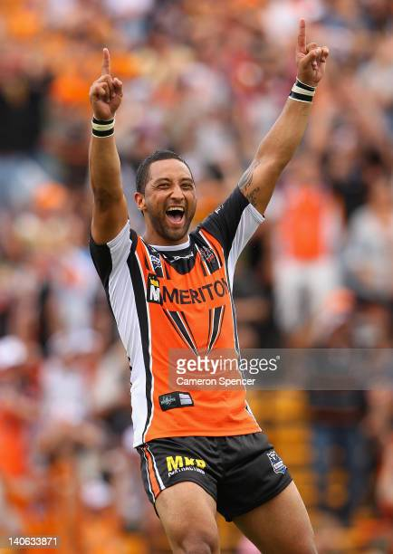 Benji Marshall of the Tigers celebrates kicking the winning drop-goal in extra time during the round one NRL match between the Wests Tigers and the...