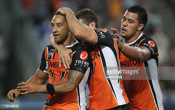Benji Marshall of the Tigers celebrates scoring a try during the round one NRL match between the Canterbury Bulldogs and the Wests Tigers at ANZ...