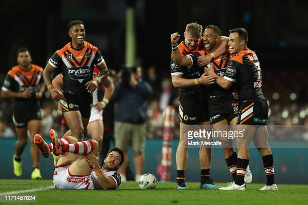 Benji Marshall of the Tigers celebrates scoring a try with team mates during the round 24 NRL match between the St George Illawarra Dragons and the...