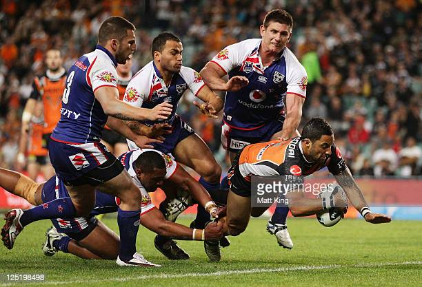 Benji Marshall of the Tigers dives over to score a try during the NRL first semi final match between the Wests Tigers and the New Zealand Warriors at...