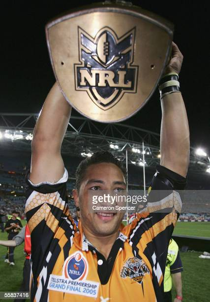 Benji Marshall of the Tigers holds the Premiership trophy aloft after winning the NRL Grand Final between the Wests Tigers and the North Queensland...