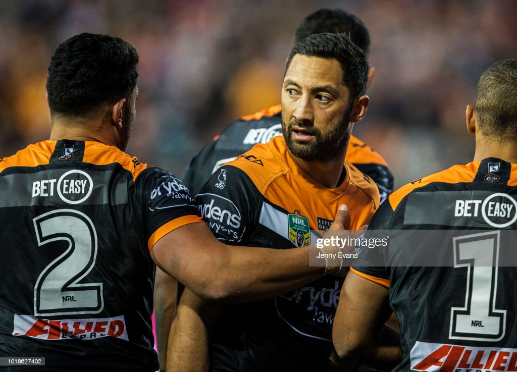 Benji Marshall of the Tigers (C) is patted by team mates after an altercation with Dragons players during the round 23 NRL match between the Wests Tigers and the St George Illawarra Dragons at Leichhardt Oval on August 18, 2018 in Sydney, Australia.