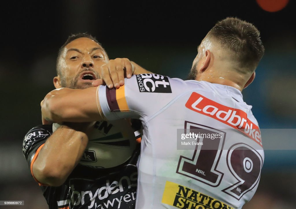 Benji Marshall of the Tigers is tackled by Jack Bird of the Broncos during the round three NRL match between the Wests Tigers and the Brisbane Broncos at Campbelltown Sports Stadium on March 23, 2018 in Sydney, Australia.