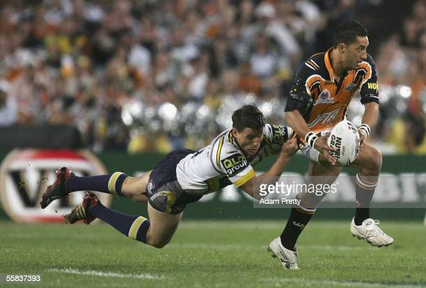 Benji Marshall of the Tigers is tackled by Josh Hannay of the Cowboys during the NRL Grand Final between the Wests Tigers and the North Queensland...