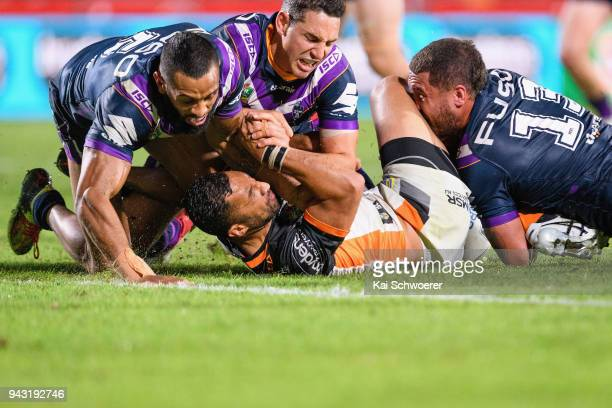 Benji Marshall of the Tigers is tackled during the round five NRL match between the Wests Tigers and the Melbourne Storm at Mt Smart Stadium on April...