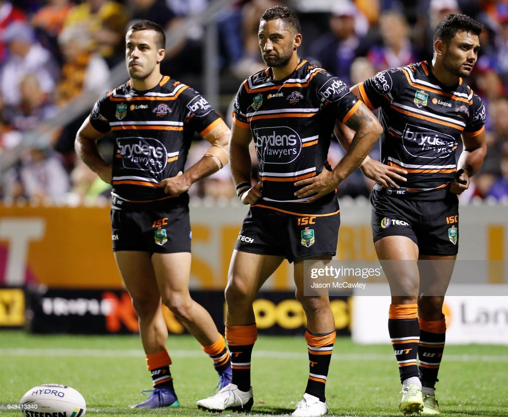 Benji Marshall (centre) of the Tigers looks dejected during the round seven NRL match between the Wests Tigers and the Newcastle Knights at Scully Park on April 21, 2018 in Tamworth, Australia.