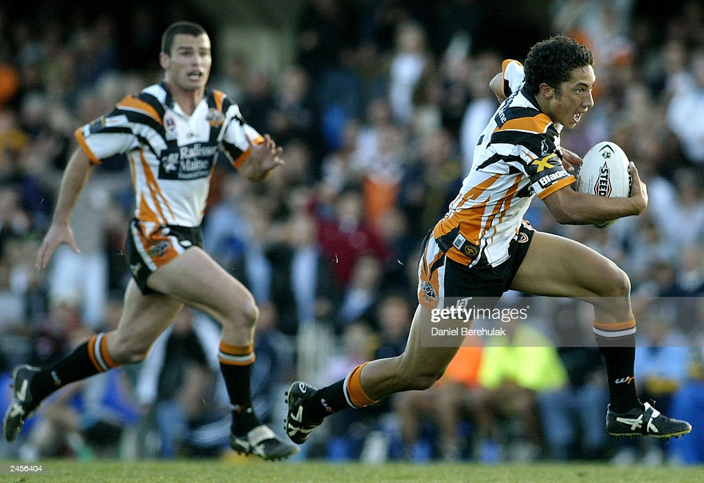 Benji Marshall #7 of the Tigers makes a break during the round 25 NRL match between the Wests Tigers and the North Queensland Cowboys at Campbelltown Oval August 31, 2003 in Sydney, Australia.
