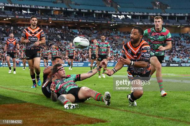 Benji Marshall of the Tigers passes during the round 11 NRL match between the South Sydney Rabbitohs and the Wests Tigers at ANZ Stadium on May 25...