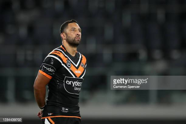 Benji Marshall of the Tigers pays his respects during a minutes silence for the late Arthur Summons during the round three NRL match between the...