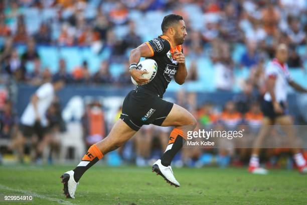 Benji Marshall of the Tigers runs the ball during the round one NRL match between the Wests Tigers and the Sydney Roosters at ANZ Stadium on March 10...