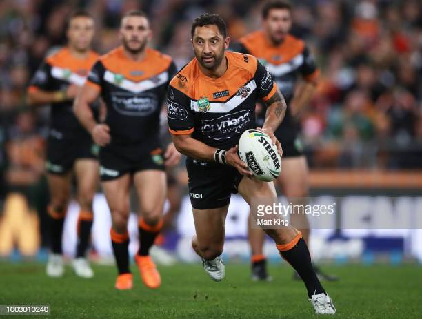 Benji Marshall of the Tigers runs with the ball during the round 19 NRL match between the Wests Tigers and the South Sydney Rabbitohs at ANZ Stadium...