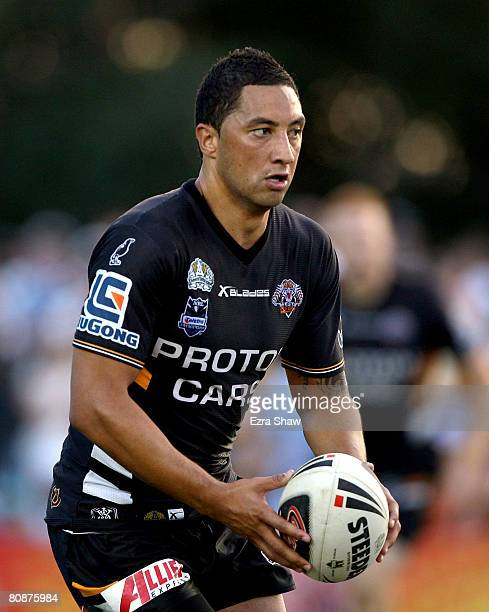 Benji Marshall of the Tigers runs with the ball during the round seven NRL match between the Cronulla Sharks and the Wests Tigers at Toyota Stadium...
