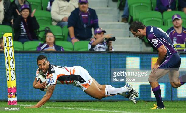 Benji Marshall of the Tigers scores a try past Cameron Smith of the Storm during the round 5 NRL match between the Melbourne Storm and the Wests...