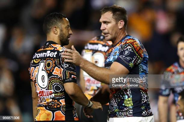 Benji Marshall of the Tigers shakes hands with Scott Bolton of the Cowboys following the round 10 NRL match between the Wests Tigers and the North...