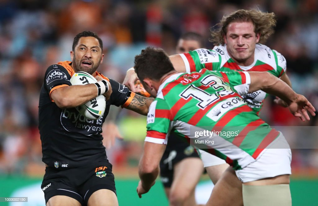 Benji Marshall of the Tigers takes on the defence during the round 19 NRL match between the Wests Tigers and the South Sydney Rabbitohs at ANZ Stadium on July 21, 2018 in Sydney, Australia.