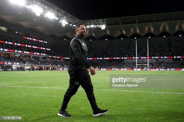 Benji Marshall of the Tigers thanks fans after playing in his last game for the Tigers following the round 20 NRL match between the Wests Tigers and...