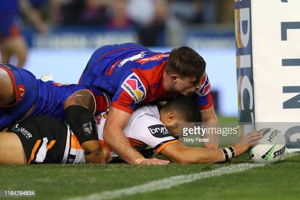 Benji Marshall of the Wests Tigers scores a try during the round 19 NRL match between the Newcastle Knights and Wests Tigers at McDonald Jones...