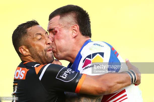 Benji Marshall of the Wests Tigers tackles David Klemmer of the Knights during the round 2 NRL match between the Wests Tigers and the Newcastle...