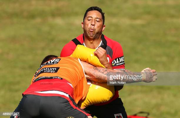 Benji Marshall takes part in a defensive drill during a St George Illawarra Dragons NRL training session at WIN Stadium on May 13, 2014 in...