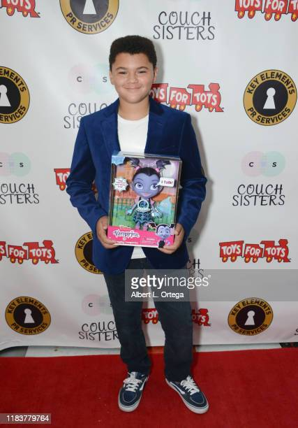 Benji Risley attends The Couch Sisters 1st Annual Toys For Tots Toy Drive held onNovember 20 2019 in Glendale California