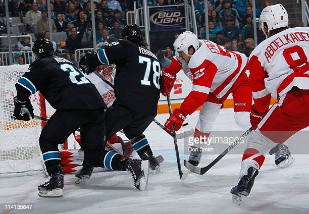 Benn Ferriero and Scott Nichol of the San Jose Sharks crash the net against Jonathan Ericsson and Justin Abdelkader of the Detroit Red Wings in Game...
