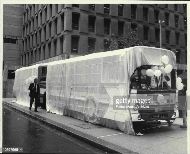 SRA benndy bus painted up for a promotion for the XPT unveiled todayThe bus under wraps in Martin Place as rain falls November 30 1984