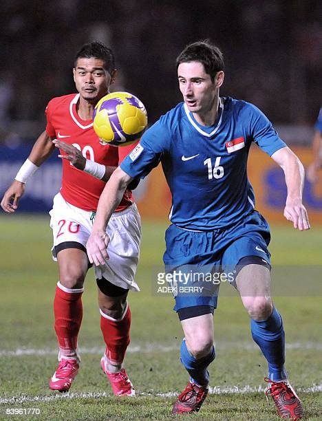 Bennet Daniel Mark of Singapore vies for the ball with Bambang Pamungkas of Indonesia during the AFF Suzuki 2008 Cup against Singapore's team in...