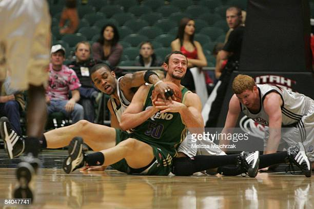 Bennet Davis and Steve Newman of the Utah Flash go for the loose ball against Jesse Smith of the Reno Bighorns at McKay Events Center on December 15...