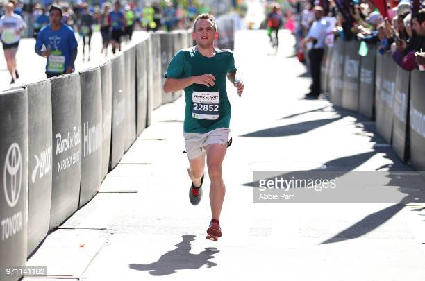 Bennett Grimes crosses the finish line to place second in the Men's Marathon during the St Jude Rock 'n' Roll Seattle Marathon 1/2 Marathon on June...