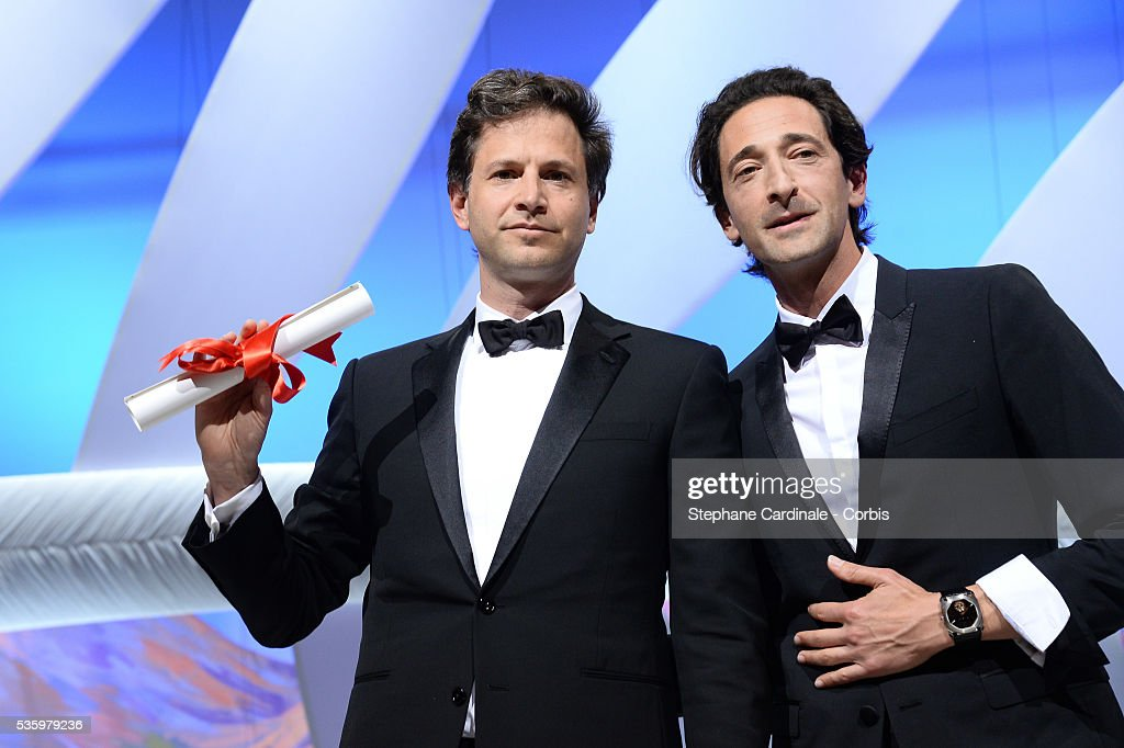 Bennett Miller, winner of the Best Director Prize for his film 'Foxcatcher', poses witn actor Adrien Brody at the Closing Ceremony during 67th Cannes Film Festival