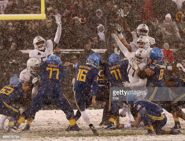 Bennett Moehring of the Navy Midshipmen attempts a field goal in the final seconds of the game but misses giving the win to the Army Black Knights on...