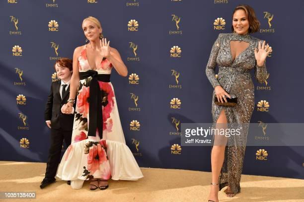 Bennett Robert Godley Jane Krakowski and Chrissy Teigen attend the 70th Emmy Awards at Microsoft Theater on September 17 2018 in Los Angeles...