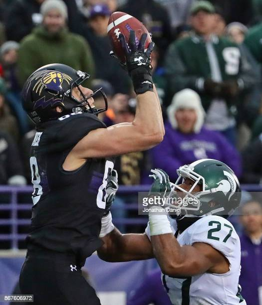 Bennett Skowronek of the Northwestern Wildcats catches a touchdown pass over Khari Willis of the Michigan State Spartans at Ryan Field on October 28...