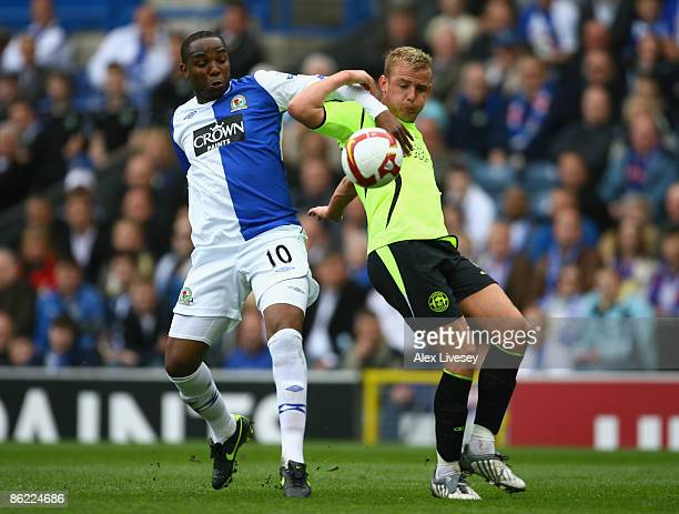 Benni McCarthy of Blackburn Rovers battles for the ball with Lee Cattermole of Wigan Athletic during the Barclays Premier League match between...