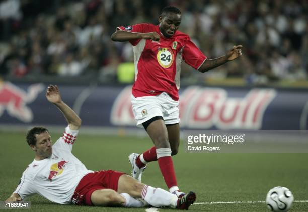 Benni McCarthy of Blackburn Rovers is brought down by Thomas Linke of Salzburg during the UEFA Cup first round first leg match between Red Bull...