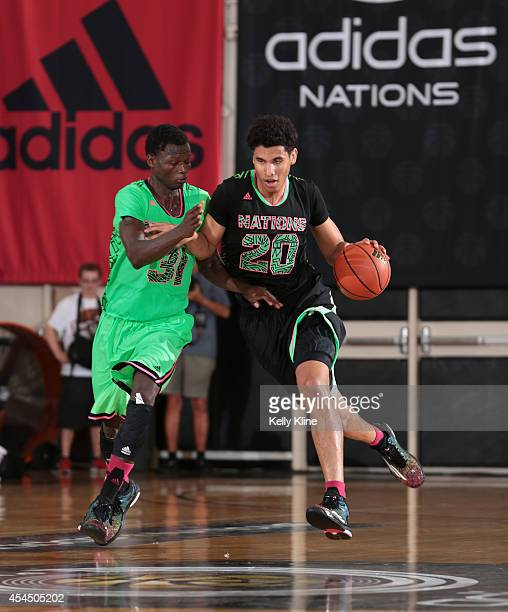 Bennie Boatwright brings the ball up the court during the 2014 adidas Nations consolation game between 2015 adidas US Howard and adidas Europe on...